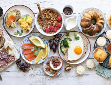 Brunch. Family breakfast or brunch set served on rustic wooden table. Overhead view, copy space